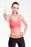 Attractive content young sportswoman giving a bottle of water Royalty Free Stock Photo