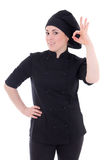 Attractive cook woman in black uniform showing ok sign isolated Royalty Free Stock Images