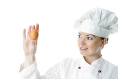 Attractive cook woman with egg Stock Photography