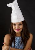 Attractive cook woman. Isolated on black background smiling stock photo