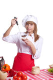 Attractive cook woman a over white background Royalty Free Stock Photography