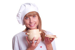 Attractive cook woman a over white background Royalty Free Stock Images