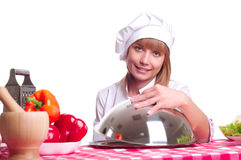 Attractive cook woman a over white background Royalty Free Stock Photos