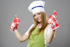 Attractive cook woman showing ok over gray Stock Images