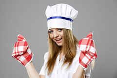 Attractive cook woman showing ok over gray Royalty Free Stock Photos