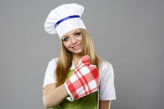 Attractive cook woman showing ok over gray Stock Photos