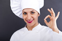 Attractive cook woman showing ok and smile Stock Photo