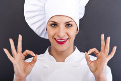 Attractive cook woman showing ok and smile Stock Images