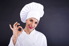 Attractive cook woman showing ok and smile Stock Image