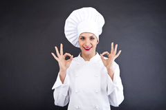Attractive cook woman showing ok and smile Royalty Free Stock Photo