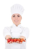 Attractive cook woman in uniform with tomatoes isolated on white Stock Images