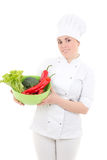 Attractive cook woman in uniform with vegetarian food isolated o Stock Photo