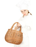 Attractive cook woman with wicker basket Stock Photos