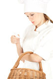 Attractive cook woman with wicker basket Royalty Free Stock Image