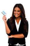 Attractive corporate lady displaying credit card Royalty Free Stock Photo