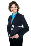 Attractive corporate lady with files in hand Stock Image