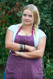 Attractive country woman with lush breast and clasped hands Stock Photos