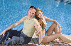 Attractive Couple. Has a rest at pool stock photography