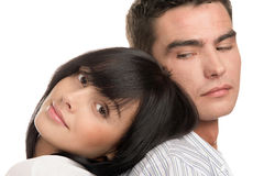 Attractive couple. Attractive young couple, woman resting head on man's back isolated on white background royalty free stock photography