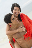 Attractive couple. An attractive couple having fun outdoors, the men carries the woman Stock Image