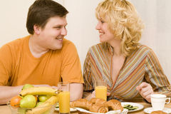 Attractive couple. Have a breakfast at the table Stock Photo