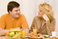 Attractive couple. Have a breakfast at the table Stock Image