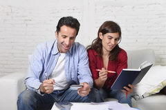 Attractive couple accounting debt at home couch happy in financial success and wealth Stock Photos