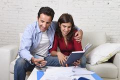 Attractive couple accounting debt at home couch happy in financial success and wealth Royalty Free Stock Photography
