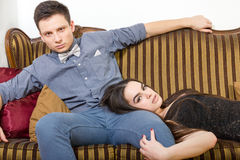 Attractive couple at ancient room sitting on couch or sofa Stock Photos