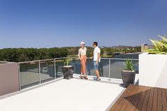 Attractive couple on balcony Royalty Free Stock Images