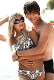 Attractive couple on a beach Stock Images