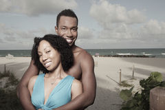 Attractive couple on the beach Stock Photography