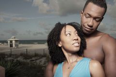Attractive couple on the beach Stock Images