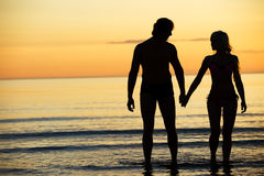 Attractive couple on the beach Royalty Free Stock Photo