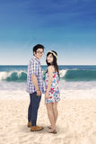 Attractive couple at beach Stock Images