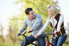 Attractive couple on bicycles Stock Photo