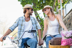 Attractive couple on a bike ride Royalty Free Stock Photography
