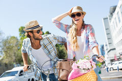 Attractive couple on a bike ride Royalty Free Stock Photo