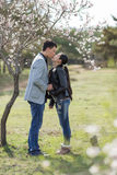 Attractive couple in blossoming park Royalty Free Stock Images