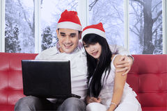 Attractive couple buy online in winter day Stock Photo