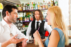 Attractive couple in cafe or coffeeshop Stock Photo