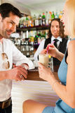 Attractive couple in cafe or coffeeshop Royalty Free Stock Photo