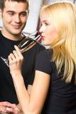 Attractive couple celebrating Stock Photos
