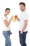 Attractive couple clinking glasses smiling Stock Photo