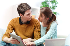 Attractive couple consulting something on a touchpad Royalty Free Stock Photos