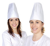 Attractive couple of cook girls Royalty Free Stock Photo