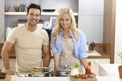 Attractive couple cooking at home Stock Photo