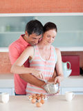 Attractive couple cooking together Stock Photos
