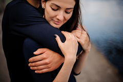 Attractive couple cuddling at the beach Royalty Free Stock Image
