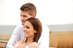 Attractive Couple Cuddling Outdoors Stock Images